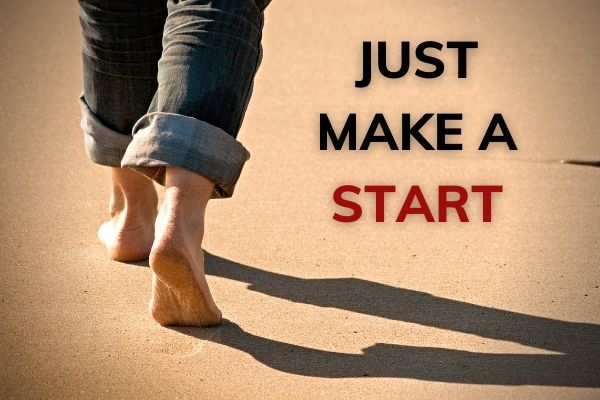Picture of feet walking on sand. Text reeads 'just make a start'.