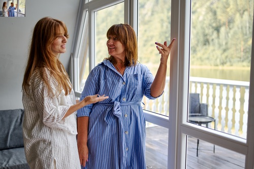 Picture of two ladies talking in a house