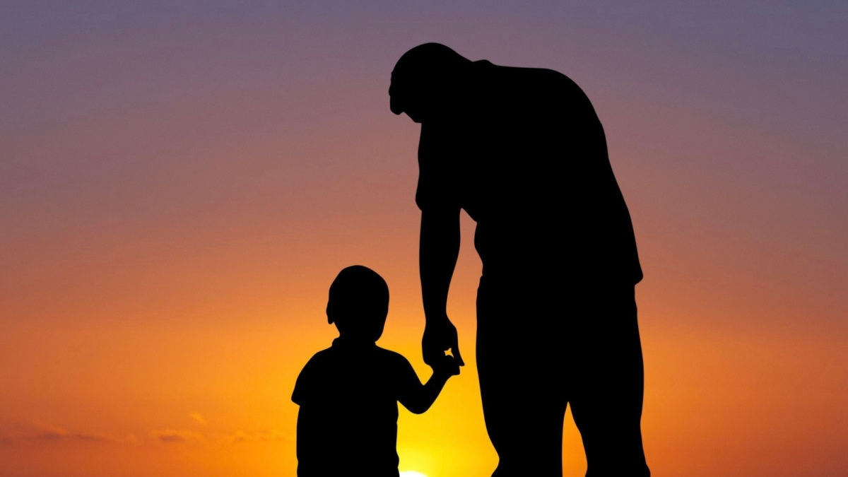 Picture of Father and child outlined in the sunset