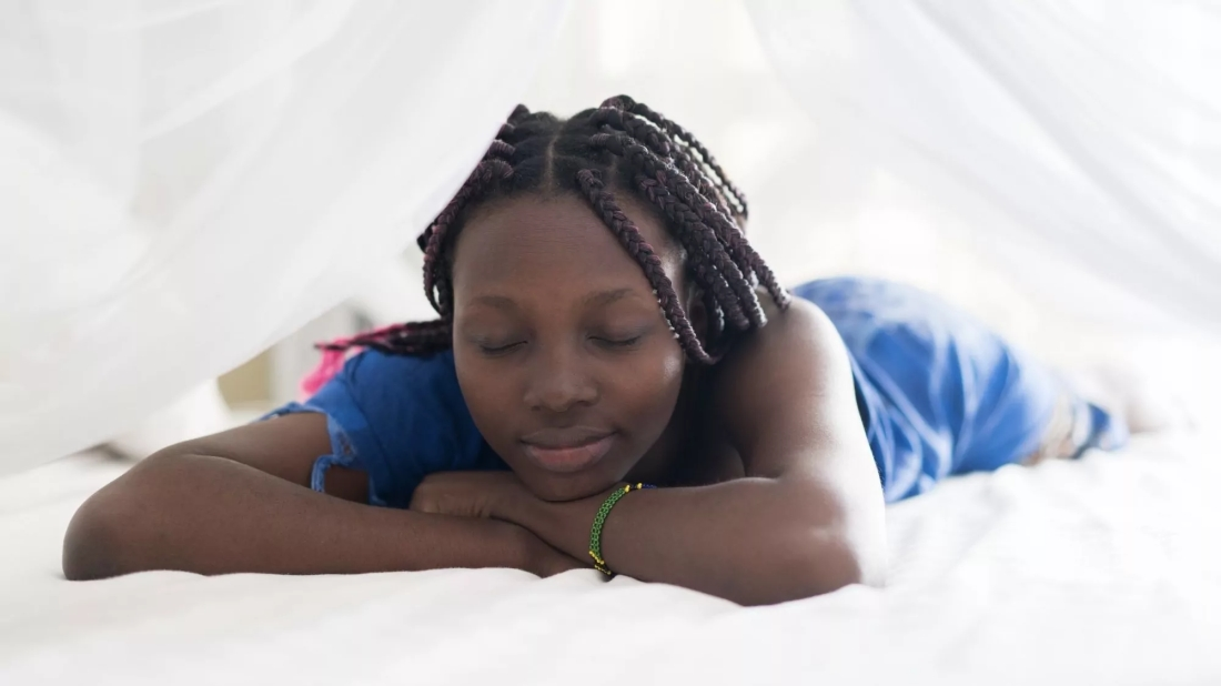Picture of lady lying on bed with eyes closed