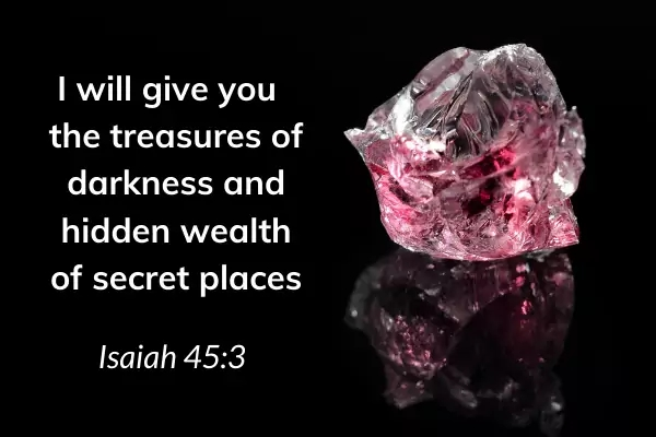 Picture of jewels on black background with text: Isaiah 45:3 I will give you treasures of darkness and hidden wealth of secret places