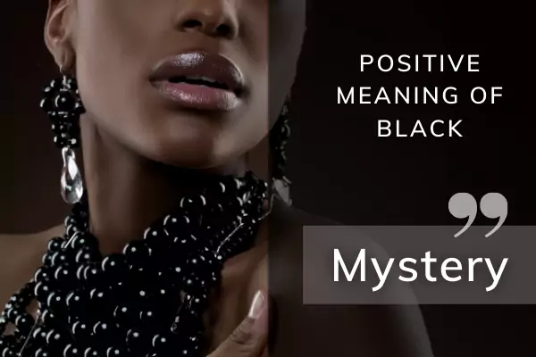Picture of lady wearing black jewellery with text: positive meaning of black kin dreams - mystery